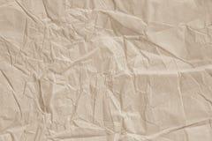 Fermez-vous de la feuille brillante de papier de texture de ride la lumière a modifié la tonalité l'art images stock