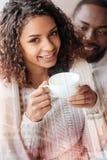 Fermez-vous de la fille gaie avec une tasse de café Images libres de droits