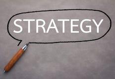 Fermez-vous de la stratégie commerciale images stock