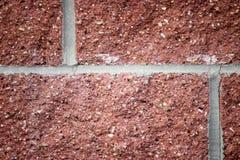 Fermez-vous de la texture détaillée d'un mur de briques rouge Photo libre de droits