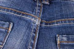 Fermez-vous de la texture de jeans Images stock