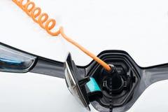 Fermez-vous de la voiture électrique chargeant Images stock
