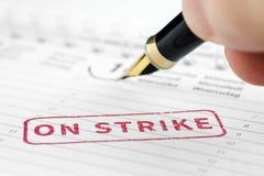 Fermez-vous de sur le timbre de grève photo stock
