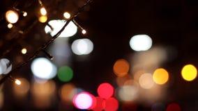 Fermez-vous des ampoules de guirlande Effet de Bokeh Décoration pendant Noël et la nouvelle année banque de vidéos