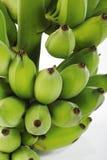 Fermez-vous des bananes vertes Photographie stock libre de droits