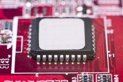 Fermez-vous des circuits électroniques en technologie sur Mainboard photo libre de droits