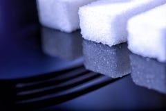Fermez-vous des cubes en sucre avec l'ombre folklorique Photographie stock libre de droits