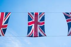 Fermez-vous des drapeaux britanniques volant en Regent Street London pour célébrer le mariage royal de prince Harry à Meghan Mark images libres de droits