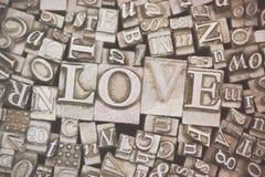 Fermez-vous des lettres composées avec l'amour de mot Photo stock