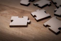 Fermez-vous des morceaux d'un puzzle photo stock