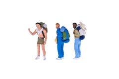 Fermez-vous des personnes miniatures de randonneur et de touriste Photo libre de droits