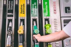 Fermez-vous des pompes d'un diesel et d'essence de station service image stock