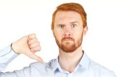 fermez-vous des pouces déprimés jeune par homme d'affaires vers le bas Images stock