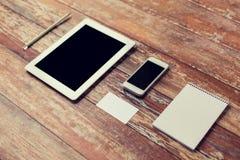 Fermez-vous du carnet, du PC de comprimé et du smartphone Photographie stock libre de droits