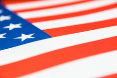 Fermez-vous du drapeau de papier des Etats-Unis, foyer sélectif sur une étoile Image stock