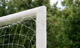 Fermez-vous du but du football Photographie stock