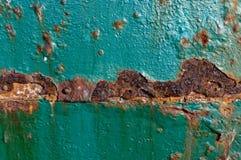 Fermez-vous du métal ouvré de rouillement photographie stock