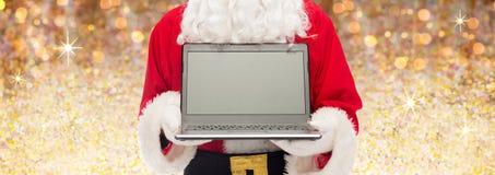 Fermez-vous du père noël avec l'ordinateur portable Photo libre de droits
