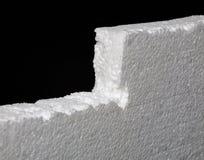 Fermez-vous du polystyrène augmenté sur le fond noir photographie stock
