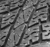 Fermez-vous du vieux fond de texture de pneu de voiture Image stock