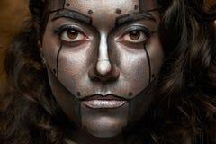 Fermez-vous du visage de cyborg photographie stock