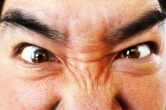 Fermez-vous du visage de l'homme fâché Photographie stock