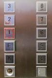 Fermez-vous sur des boutons d'ascenseur Image stock