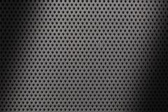 Fermez-vous sur une texture métallique de feuille avec de petits trous et nuances image libre de droits