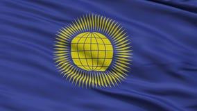 Fermez-vous vers le haut d'onduler le drapeau national du Commonwealth uni illustration libre de droits