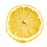 Fermez-vous vers le haut d'un citron coupé en tranches au-dessus de blanc Image libre de droits