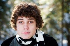 Fermez-vous vers le haut d'un garçon de l'adolescence à l'extérieur Photo stock