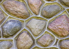 Fermez-vous vers le haut d'un mur en pierre Photographie stock libre de droits