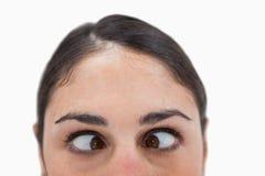 Fermez-vous vers le haut d'une femme cross-eyed Photographie stock