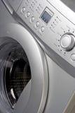Fermez-vous vers le haut d'une machine à laver Photos stock