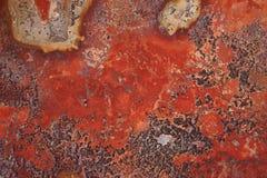 Fermez-vous vers le haut d'une texture rouge de roche Photographie stock