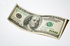 Fermez-vous vers le haut de cent billets de banque du dollar sur le fond blanc Photographie stock libre de droits