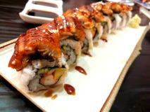 Fermez-vous vers le haut de l'anguille Anago de sushi photos stock