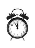 Fermez-vous vers le haut de l'horloge noire de cloche (l'horloge d'alarme) Photo stock