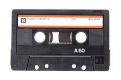 Fermez-vous vers le haut de l'image d'une bande de cassette sonore de vintage d'isolement sur le fond blanc Vue supérieure image stock