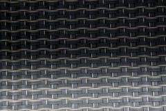 Fermez-vous vers le haut de l'image du tapis noir de tiret avec des cellules de grille Photographie stock libre de droits