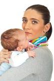 Fermez-vous vers le haut de la chéri nouveau-née de prise de mère Photos stock