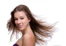 Fermez-vous vers le haut de la femme avec le cheveu de vol Photographie stock