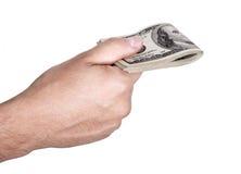 Donnant dehors l'argent liquide - plié Images libres de droits