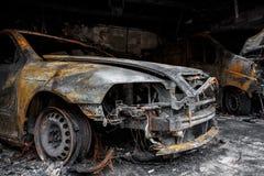 Fermez-vous vers le haut de la photo des voitures d'un burn-out Image stock