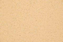 Fermez-vous vers le haut de la plage sablonneuse pour la texture et le fond Photos stock