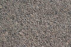 Fermez-vous vers le haut de la route grise de texture d'asphalte dans la ville Photographie stock libre de droits