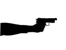 Fermez-vous vers le haut de la silhouette de canon de main d'homme du groupe un Photographie stock libre de droits