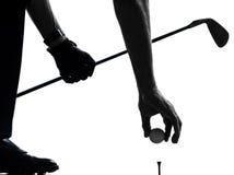Fermez-vous vers le haut de la silhouette jouante au golf de golfeur de l'homme Photographie stock