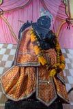 Fermez-vous vers le haut de la statue d'un dieu indou Krishna Photos stock