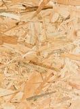 Fermez-vous vers le haut de la texture du panneau orienté de brin (OSB) Photographie stock libre de droits